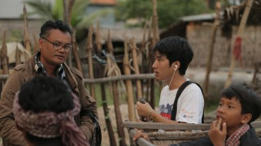 "Bunhom Chhorn directing the documentary ""Camp 32"" in Cambodia."