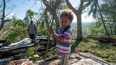 Desolation: Vanuatu residents clean up after Cyclone Pam.