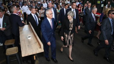 Turnbull and Ms May visit Borough Market in London.