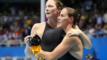 Sisters in arms: Cate and Bronte Campbell after the 100m freestyle final.