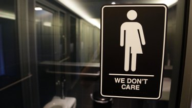 A sign outside a public toilet at 21c Museum Hotel in Durham, North Carolina, US.