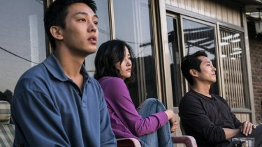 From left, Yoo Ah-in, Jun Jong-seo and Steven Yeun in Burning.