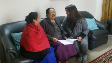 Rosemary Dzuvichu, right, and colleagues discuss  a press statement by the Naga Mothers' Association.