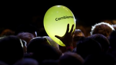Let's change: A supporter of opposition presidential candidate Mauricio Macri holds a balloon with the logo of the party in Buenos Aires, Argentina, on Sunday.