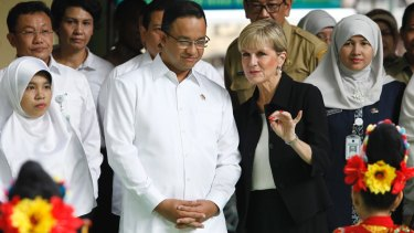 Jakarta gubernatorial candidate Anies Baswedan listens to Julie Bishop in Jakarta in March 2016, when he was a minister in the Indonesian government.