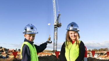 Peter ''PJ'' Woods, 7, and Charlotte Young, 10, won a competition to name the crane building the University of Canberra Public Hospital.