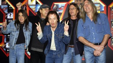 Malcolm Young, Brian Johnson, Angus Young, Phil Rudd and Cliff Williams from AC/DC at the Apollo Hammersmith in London in 2003.
