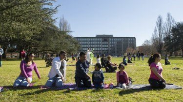 Praksh Penchl and his family participate in an outdoor yoga class to mark the official International Day of Yoga.