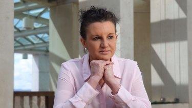 Senator Lambie breaks away from other PUP senators to back Labor's disallowance motion.
