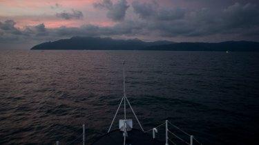 A Malaysian Maritime Enforcement agency boat patrols the coast of Langkawi Island, Malaysia.
