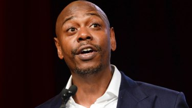 Comedian Dave Chappelle hosts NBC's Saturday Night Live, marking his debut appearance with hip-hop group A Tribe Called Quest.