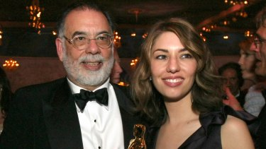 Sofia Coppola holds the Oscar she won for best original screenplay for 'Lost in Translation' with her father, Francis Ford Coppola, following the 2004 Academy Awards.