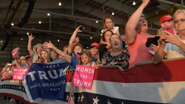 "People wait for the arrival of President Donald Trump at his ""Make America Great Again Rally"" in Florida, in their safe space."