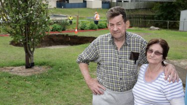Residents Ray and Lynn McKay after a massive sinkhole opened in the backyard of their Ipswich home.