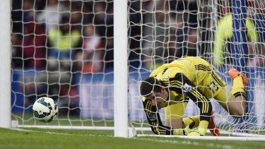 Beaten: Chelsea goalkeeper Thibaut Courtois looks dejected after Charlie Adam scored.