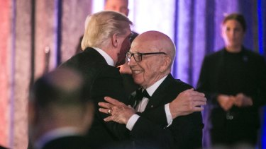 Billionaire bromance: President Trump and Rupert Murdoch embrace at a dinner honouring war veterans in May.