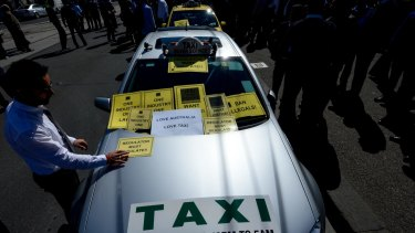 Taxi drivers protesting over Uber at Parliament House. Victoria's Taxi Services Commission says it has issued 355 infringement notices to uberX drivers.