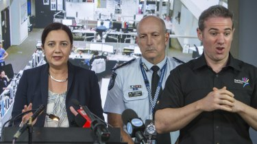 Interpreter Mark Cave, coined '#SignGuy' by media and social media, at the State Disaster Coordination Centre for a press conference with premier Annastacia Palaszczuk and emergency officials.