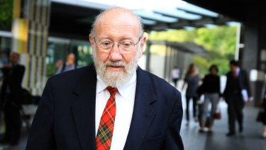 Former St Paul's School headmaster Gilbert Case leaves the Brisbane Magistrates Court on Thursday.