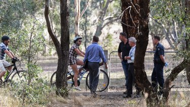 Police officers talk to other cyclists on the rail trail.