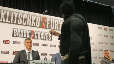 Holy title fight!: World heavyweight champion Wladimir Klitschko, may have underestimated Tyson Fury, dressed as Batman before the fight.