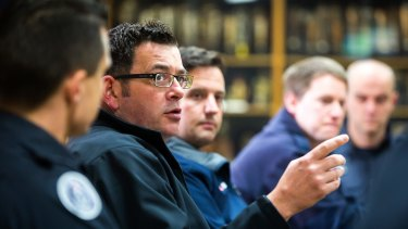 Premier Daniel Andrews in June, pointing out to firefighters how he's fixing things...
