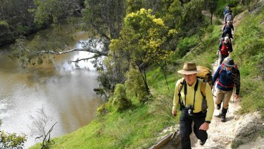 Peter Campbell leads a group of bushwalkers along a Yarra River trail.