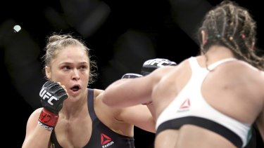 Fighters like Ronda Rousey (left) have helped the sport generate millions in revenue and tourism