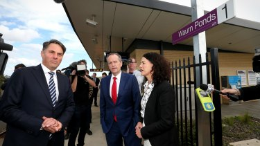 Shadow Immigration Minister Richard Marles, Opposition Leader Bill Shorten and ALP candidate for Corangamite Libby Coker address the media during a doorstop interview at the Waurn Ponds train station in Geelong.
