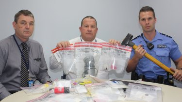Detectives with some of the material allegedly seized.