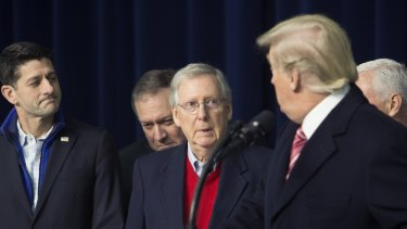 Senate Majority Leader Mitch McConnell, a Republican from Kentucky, centre, and House Speaker Paul Ryan, left, and US President Donald Trump. Republicans failed to get their bill up before the deadline.