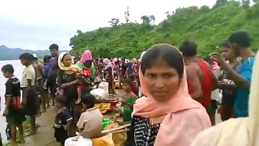 Video released by Arakan Rohingya National Organisation shows villagers preparing to cross a river towards the Maungdaw township in the Rakhine state that borders Bangladesh.