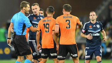 Melbourne Victory's Besart Berisha argues with the referee after being given a red card.