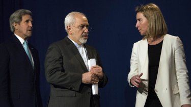 US Secretary of State John Kerry, Iranian Foreign Minister Javad Zarif and EU High Representative for Foreign Affairs Federica Mogherini arrive to deliver a statement in Lausanne.