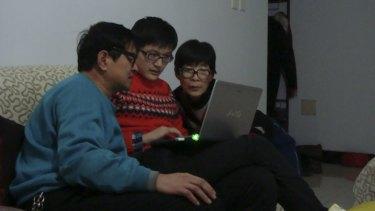 Wang Lijun, who is missing on MH370, with son Wang Zan and wife Wang Liping.