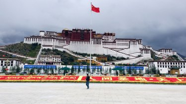 The Chinese flag flies over the Potala Palace in Lhasa, Tibet.