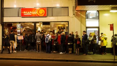 People queuing to enter Mamak restaurant in Chinatown, Sydney.