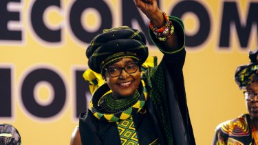 Winnie Madikizela-Mandela, wife of former president Nelson Mandela, greets the audience during the 54th national conference of the African National Congress party.