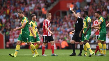 Referee Jonathan Moss gives Norwich's Steven Whittaker his marching orders.