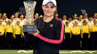 Ashleigh Barty poses with the WTA Malaysian Open Champion Trophy after beating Nao Hibino of Japan.
