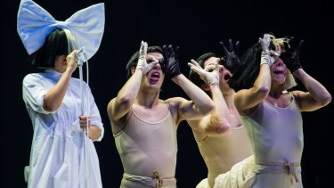 Singer Sia, left, performs as part of the V Festival at Hylands Parks, Chelmsford, Saturday, Aug 20, 2016. (Joel Ryan/Invision/Ap)