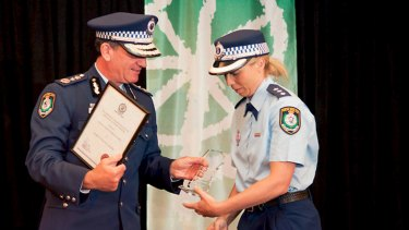 Detective Inspector Denby Lea Eardley collects an award from Commissioner Andrew Scipione in 2012.