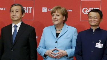 German Chancellor Angela Merkel, China's Vice Premier Ma Kai (L) and Alibaba founder and chairman Jack Ma at the official opening of the CeBIT Hanover 2015.