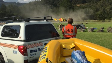 Rescue services search for a man who went missing after wading into a river in the Kangaroo Valley.