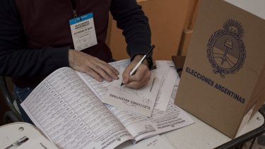 An electoral official certifies voters' envelopes at a polling station in Buenos Aires during the presidential election on Sunday.