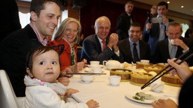 Prime Minister Malcolm Turnbull and Lucy with their granddaughter Isla and son Alex.