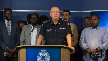 Graham Ashton speaks to the media, flanked by leaders from Melbourne's African community.