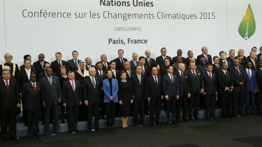 World leaders pose for a group photo at the climate conference on Monday.