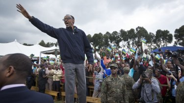 Rwanda's President Paul Kagame waves to a crowd in northern Rwanda in September.
