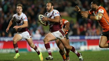 Brett Stewart makes a break for the Manly Sea Eagles against Wests Tigers in 2014.